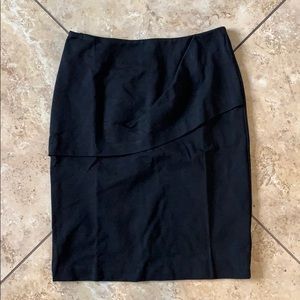 Black CAbi pencil skirt with ruffle.